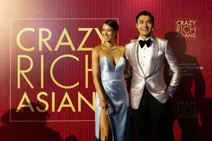Henry Golding Wife CRA Premiere Getty.jpg
