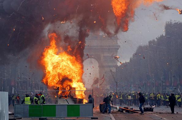 paris-protest-fire-arc-de-triomphe.jpg