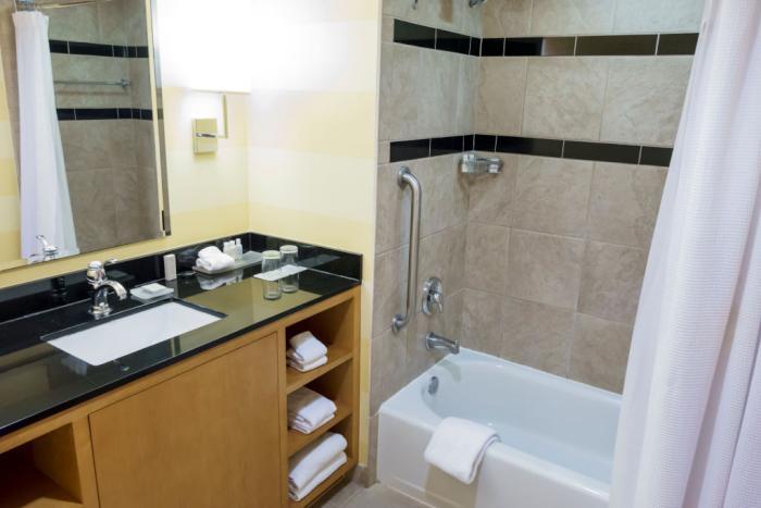 is-it-ok-to-pee-in-shower-header.jpg