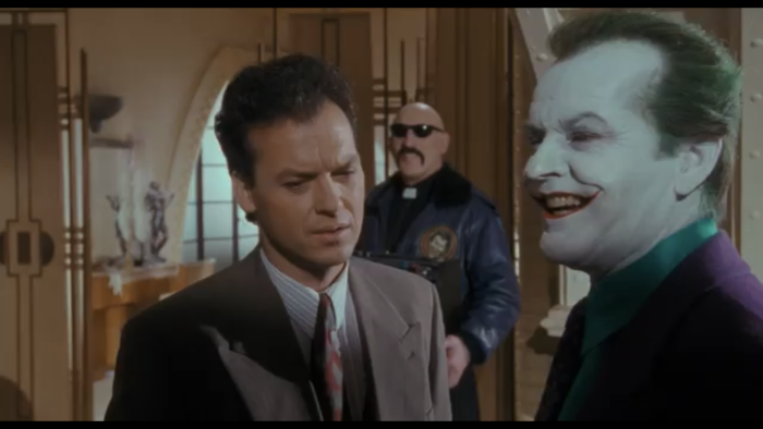 Bruce Wayne talks with Joker  Batman.png